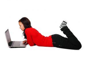 Girl using laptop computer