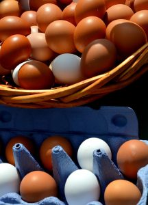 Eggs in basket and carton