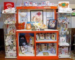 Large display cabinets full of Okami merchandise.