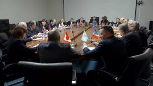 """Leaders sitting at a """"round table"""" and talking."""